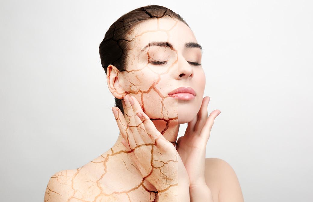 肌が砂漠のように乾燥してひび割れている女性のイメージ画像
