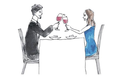 恋人たちが楽しそうにワインを飲む様子