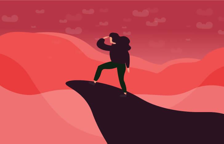 崖の先に立つ女性