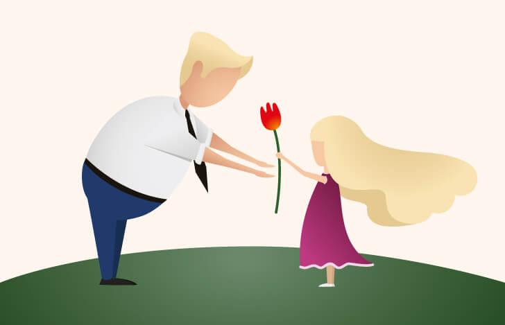 父親に花を渡す少女