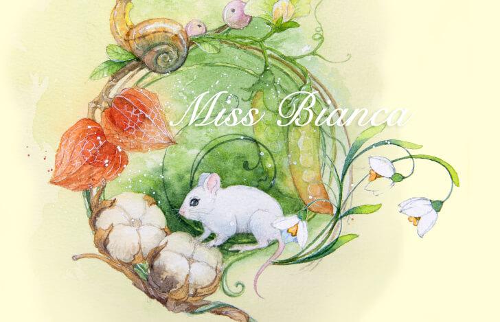白い美しいネズミと植物