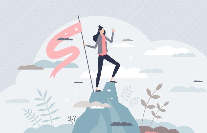 山の頂上で旗を持つ女性